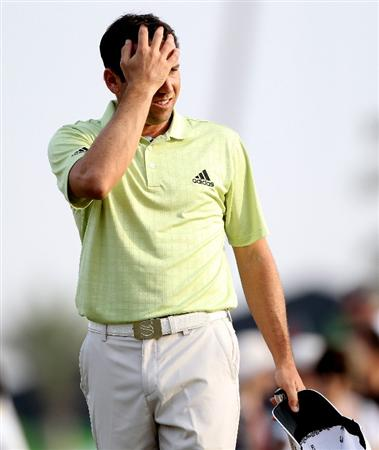 ABU DHABI, UNITED ARAB EMIRATES - JANUARY 23:  Sergio Garcia of Spain looks dejected after missing a putt on the 18th hole during the third round of The Abu Dhabi Golf Championship at Abu Dhabi Golf Club on January 23, 2010 in Abu Dhabi, United Arab Emirates.  (Photo by Andrew Redington/Getty Images)