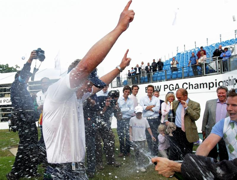 VIRGINIA WATER, ENGLAND - MAY 29:  Luke Donald of England is sprayed with champagne following his victory in a playoff during the final round of the BMW PGA Championship  at the Wentworth Club on May 29, 2011 in Virginia Water, England.  (Photo by Ross Kinnaird/Getty Images)