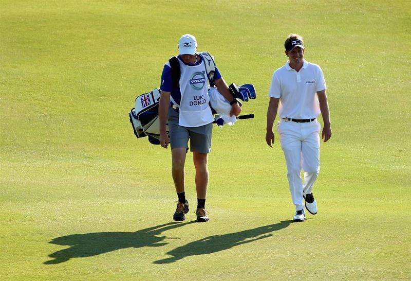 CASARES, SPAIN - MAY 22:  Luke Donald of England walks with his caddie John McLaren during the semi final of the Volvo World Match Play Championship at Finca Cortesin on May 22, 2011 in Casares, Spain.  (Photo by Andrew Redington/Getty Images)