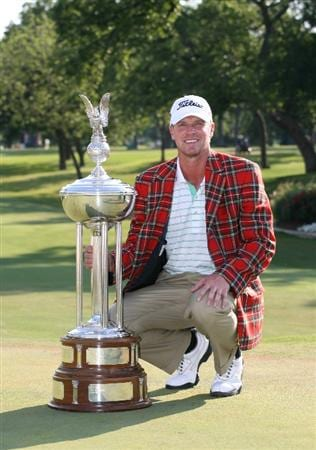 FT. WORTH, TX - MAY 31: Steve Stricker kneels next to the championship trophy after winning the Crowne Plaza Invitational at Colonial Country Club on May 31, 2009 in Ft. Worth, Texas. (Photo by Hunter Martin/Getty Images)
