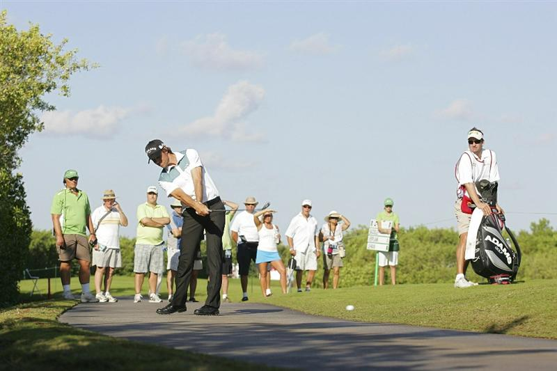 PLAYA DEL CARMEN, MEXICO - FEBRUARY 24:  Aaron Baddeley of Australia hits a shot off the cart path during the first round of the Mayakoba Golf Classic at Riviera Maya-Cancun held at El Camaleon Golf Club on February 24, 2011 in Playa del Carmen, Mexico.  (Photo by Michael Cohen/Getty Images)