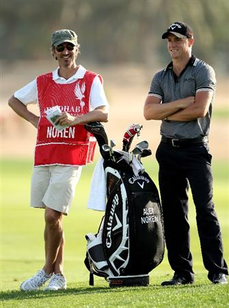 ABU DHABI, UNITED ARAB EMIRATES - JANUARY 21:  Alex Noren of Sweden waits with his caddie Colin Byrne on the ninth hole during the first round of The Abu Dhabi Golf Championship at Abu Dhabi Golf Club on January 21, 2010 in Abu Dhabi, United Arab Emirates.  (Photo by Andrew Redington/Getty Images)
