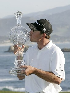 Arron Oberholser celebrates with the trophy after winning during the final round of the  AT&T Pebble Beach National Pro-Am on Pebble Beach Golf Links in Pebble Beach, California on February 12, 2006.Photo by Chris Condon/PGA TOUR/WireImage.com