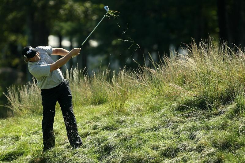 NORTON, MA - SEPTEMBER 04:  Steve Marino hits a shot out of the rough on the 17th hole during the second round of the Deutsche Bank Championship at TPC Boston on September 4, 2010 in Norton, Massachusetts.  (Photo by Mike Ehrmann/Getty Images)