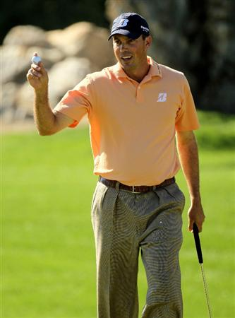 LA QUINTA, CA - JANUARY 25:  Matt Kuchar holds up his ball after making a birdie putt on the 11th hole at the Palmer Private course at PGA West during the final round of the Bob Hope Classic on January 25, 2010 in La Quinta, California.  (Photo by Stephen Dunn/Getty Images)
