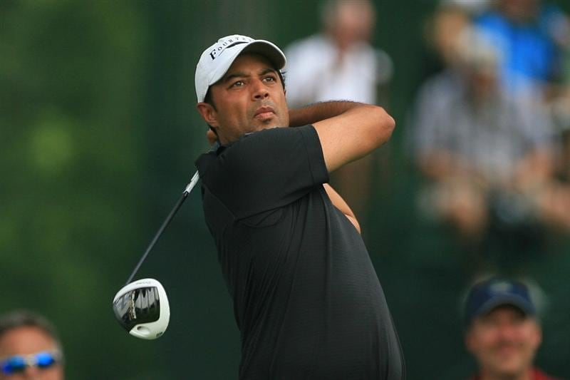 FORT WORTH, TX - MAY 22: Arjun Atwal of India hits his tee shot on the third hole during the final round of the Crowne Plaza Invitational at Colonial Country Club on May 22, 2011 in Fort Worth, Texas. (Photo by Hunter Martin/Getty Images)