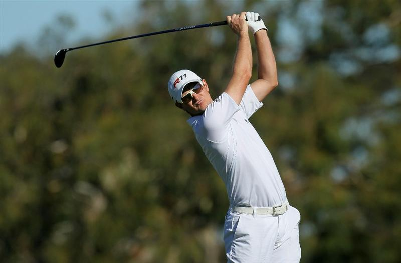 LA JOLLA, CA - JANUARY 27:  Justin Rose of England hits his tee shot on the second hole during round one of the Farmers Insurance Open at Torrey Pines North Course on January 27, 2011 in La Jolla, California.  (Photo by Stephen Dunn/Getty Images)
