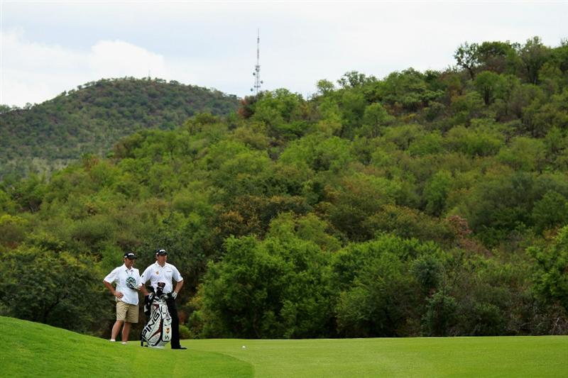 SUN CITY, SOUTH AFRICA - DECEMBER 03:  Lee Westwood of England stands with his caddie Billy Foster during the second round of the 2010 Nedbank Golf Challenge at the Gary Player Country Club Course  on December 3, 2010 in Sun City, South Africa.  (Photo by Warren Little/Getty Images)