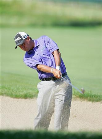 CROMWELL, CT - JUNE 25:  Chris DiMarco hits a shot from a fairway bunker during the second round of the Travelers Championship held at TPC River Highlands on June 25, 2010 in Cromwell, Connecticut.  (Photo by Michael Cohen/Getty Images)