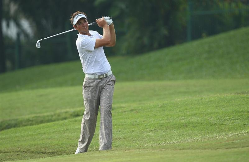 KUALA LUMPUR, MALAYSIA - FEBRUARY 13:  Nick Dougherty of England in action during the round two of the 2009 Maybank Malaysian Open at Saujana Golf and Country Club on February 13, 2009 in Kuala Lumpur, Malaysia.  (Photo by Ian Walton/Getty Images)