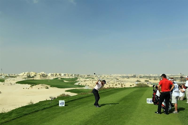 BAHRAIN, BAHRAIN - JANUARY 30:  Paul Casey of England plays his tee shot at the 3rd hole during the final round of the 2011 Volvo Champions held at the Royal Golf Club on January 30, 2011 in Bahrain, Bahrain.  (Photo by David Cannon/Getty Images)