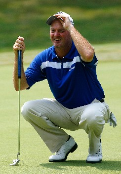 GREENSBORO, NC - AUGUST 16:  Jerry Kelly lines up his putt on the fifth green during the third round of the 2008 Wyndham Championship at Sedgefield Country Club on August 16, 2008 in Greensboro, North Carolina.  (Photo by Kevin C. Cox/Getty Images)