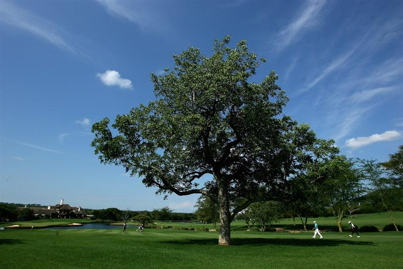 NELSPRUIT, SOUTH AFRICA - DECEMBER 13:  Golfers walk to the 18th green during the third round of the Alfred Dunhill Championship at Leopard Creek Country Club on December 13, 2008 in Malelane, South Africa.  (Photo by Warren Little/Getty Images)