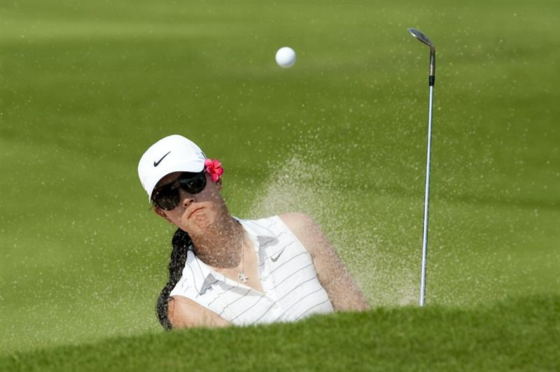 CHON BURI, THAILAND - FEBRUARY 19:  Michelle Wie of USA plays a bunker shot on the 12th hole during day three of the LPGA Thailand at Siam Country Club on February 19, 2011 in Chon Buri, Thailand.  (Photo by Victor Fraile/Getty Images)