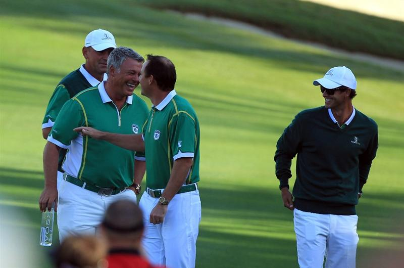 ORLANDO, FL - MARCH 14:  Darren Clarke of Northern Ireland (second from left) David Howell of England (second from right) and Thomas Bjorn of Denmark (left) playing for the Queenwood Club arrives on the 1st fairway during the first day of the 2011 Tavistock Cup at Isleworth Golf Club on March 14, 2011 in Orlando, Florida.  (Photo by David Cannon/Getty Images)