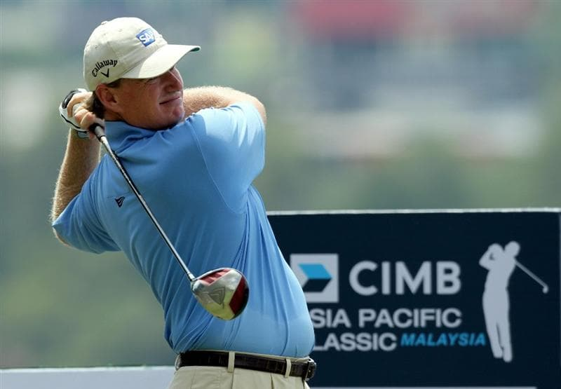KUALA LUMPUR, MALAYSIA - OCTOBER 28: Ernie Els of South Africa tees off on the 11th hole during day one of the CIMB Asia Pacific Classic at The MINES Resort & Golf Club on October 28, 2010 in Kuala Lumpur, Malaysia. (Photo by Stanley Chou/Getty Images)