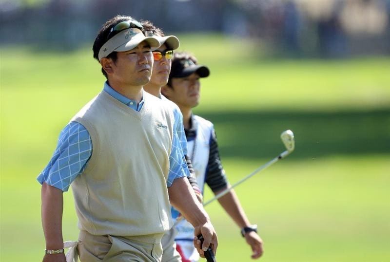 SAN FRANCISCO - OCTOBER 09:  Y.E.Yang of South Korea and the International Team with Ryo Ishikawa of Japan against Kenny Perry and Sean O'Hair of the USA team at the 7th hole during the Day Two Fourball Matches in The Presidents Cup at Harding Park Golf Course on October 9, 2009 in San Francisco, California  (Photo by David Cannon/Getty Images)