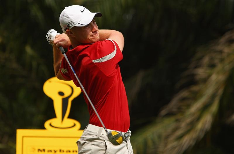 KUALA LUMPUR, MALAYSIA - FEBRUARY 13:  Oliver Fisher of England in action during the round two of the 2009 Maybank Malaysian Open at Saujana Golf and Country Club on February 13, 2009 in Kuala Lumpur, Malaysia.  (Photo by Ian Walton/Getty Images)