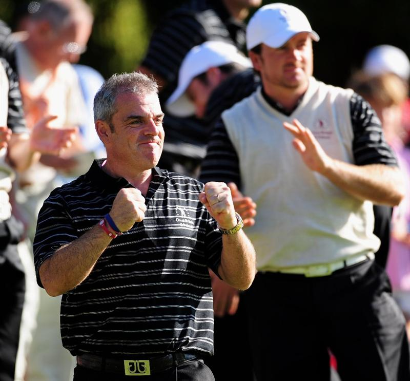 PARIS - SEPTEMBER 25:  Paul McGinley, Captain of the Great Britian and Northern Ireland team celebrates on the 16th hole during the second day fourball at the Vivendi Trophy with Severiano Ballesteros at Saint - Nom - La Breteche golf course on September 25, 2009 in Paris, France.  (Photo by Stuart Franklin/Getty Images)
