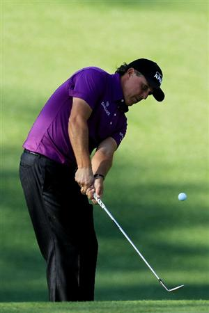 AUGUSTA, GA - APRIL 07:  Phil Mickelson chips onto the tenth green during the first round of the 2011 Masters Tournament at Augusta National Golf Club on April 7, 2011 in Augusta, Georgia.  (Photo by David Cannon/Getty Images)