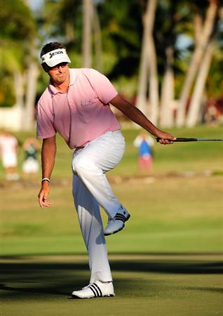 HONOLULU - JANUARY 17:  Robert Allenby of Australia reacts to a missed birdie attempt on the 17th hole during the final round of the Sony Open at Waialae Country Club on January 17, 2010 in Honolulu, Hawaii.  (Photo by Sam Greenwood/Getty Images)