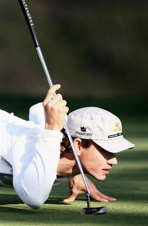 LA JOLLA, CA - FEBRUARY 08: Camilo Villegas of Columbia lines up his putt on the 4th hole during the Final Round of the Buick Invitational at the Torrey Pines North Course on February 8, 2009 in La Jolla, California. (Photo by Donald Miralle/Getty Images)