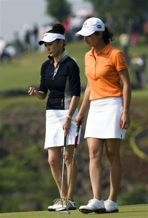 HAIKOU, CHINA - OCTOBER 30:  Lorena Ochoa (R) of Mexico and Catherine Zeta-Jones stand on the 9th green during day four of the Mission Hills Start Trophy tournament at Mission Hills Resort on October 30, 2010 in Haikou, China. The Mission Hills Star Trophy is Asia's leading leisure liflestyle event and features Hollywood celebrities and international golf stars.  (Photo by Victor Fraile/Getty Images for Mission Hills)