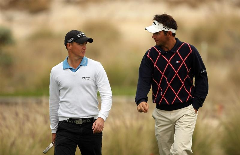 DOHA, QATAR - JANUARY 23:  Alex Noren of Sweden (left) chats with Nick Dougherty of England on the 13th hole during the second round of  the Commercialbank Qatar Masters at Doha Golf Club on January 23, 2009 in Doha, Qatar.  (Photo by Andrew Redington/Getty Images)