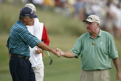 Morris Hatalsky and Allen Doyle congratulate each other after completing the third round of the U.S. Senior Open at Prairie Dunes Country Club in Hutchinson,  Kansas on July 8, 2006.Photo by G. Newman Lowrance/WireImage.com
