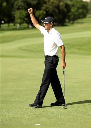 JOHANNESBURG, SOUTH AFRICA - JANUARY 16:  Charl Schwartzel of South Africa celebrates winning the Joburg Open at Royal Johannesburg and Kensington Golf Club on a score of -19 under par on January 16, 2011 in Johannesburg, South Africa.  (Photo by Warren Little/Getty Images)