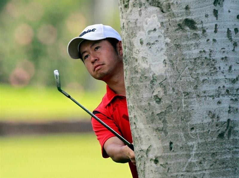 HONOLULU, HI - JANUARY 15:  Michio Matsumura of Japan plays a shot on the 5th hole during the second round of the Sony Open at Waialae Country Club on January 15, 2011 in Honolulu, Hawaii.  (Photo by Sam Greenwood/Getty Images)