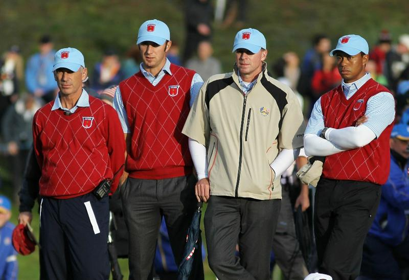 NEWPORT, WALES - OCTOBER 03: (L-R) USA Captain Corey Pavin waits alongside Dustin Johnson, Steve Stricker and Tiger Woods on the 18th green during the Fourball & Foursome Matches during the 2010 Ryder Cup at the Celtic Manor Resort on October 3, 2010 in Newport, Wales.  (Photo by Jamie Squire/Getty Images)