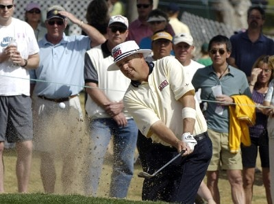 Kirk Triplett blasts out of the breenside bunker on the par three 12th during the final round of the 2006 Chrysler Classic of Tucson on Sunday , February 26, 2006 at the Omni Tucson National Golf Resort and Spa in Tucson, ArizonaPhoto by Marc Feldman/WireImage.com