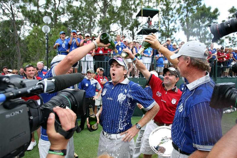 ORLANDO, FL - MARCH 17:  Ian Poulter of England and of the Lake Nona Team is doused with champagne in a celebration during the second day of the 2009 Tavistock Cup at the Lake Nona Golf and Country Club, on March 17, 2009 in Orlando, Florida  (Photo by David Cannon/Getty Images)