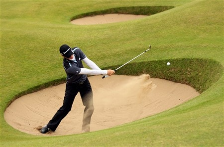 BIRKDALE, UNITED KINGDOM - JULY 14: Justin Rose of England plays out from a bunker on the 15th hole during the first practice round of the 137th Open Championship on July 14, 2008 at Royal Birkdale Golf Course, England. (Photo by Andrew Redington/Getty Images)
