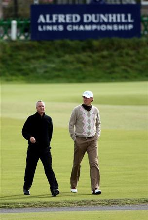 ST ANDREWS, SCOTLAND - OCTOBER 01:  Maarten Lafeber of Holland (right) walks with his playing partner Johan Cruyff, Holland football legend, on the first hole during the first round of The Alfred Dunhill Links Championship at The Old Course on October 1, 2009 in St. Andrews, Scotland.  (Photo by Andrew Redington/Getty Images)