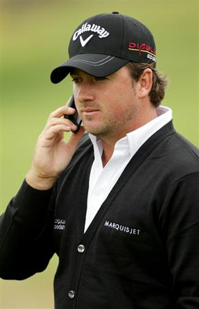 PEBBLE BEACH, CA - JUNE 14:  Graeme McDowell of Northern Ireland talks on a cell phone during a practice round prior to the start of the 110th U.S. Open at Pebble Beach Golf Links on June 14, 2010 in Pebble Beach, California.  (Photo by Andrew Redington/Getty Images)