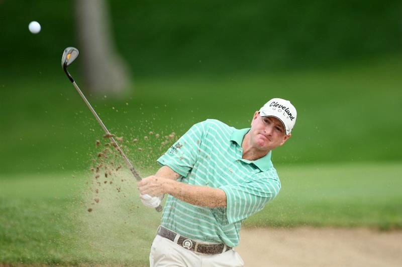 CHASKA, MN - AUGUST 16:  Steve Flesch plays a shot from a bunker on the 18th hole during the final round of the 91st PGA Championship at Hazeltine National Golf Club on August 16, 2009 in Chaska, Minnesota.  (Photo by David Cannon/Getty Images)