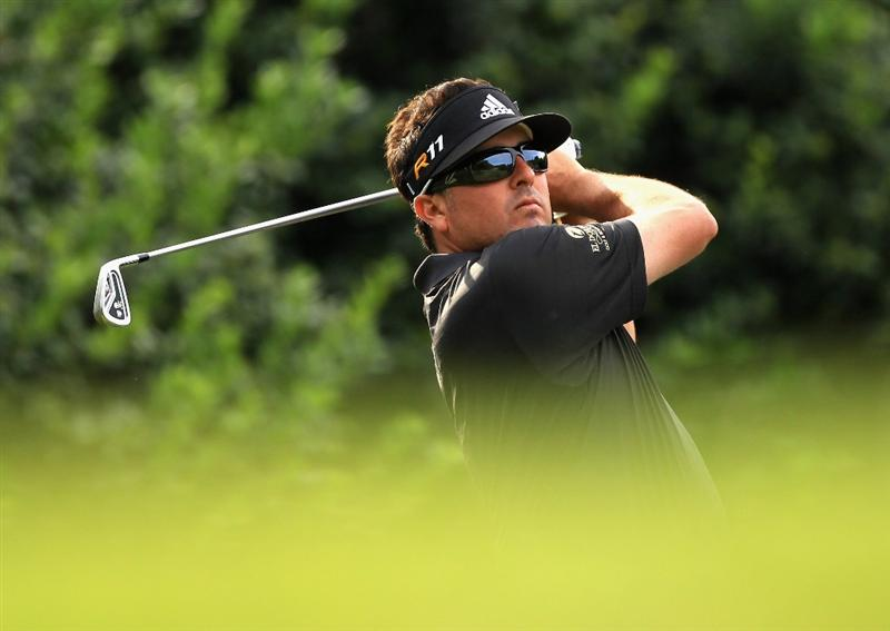CHARLOTTE, NC - MAY 07:  Pat Perez watches his tee shot on the 13th hole during the third round of the Wells Fargo Championship at Quail Hollow Club on May 7, 2011 in Charlotte, North Carolina.  (Photo by Streeter Lecka/Getty Images)