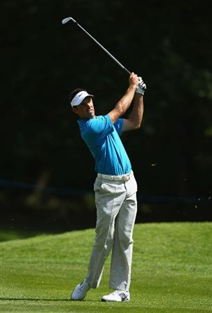 VIRGINIA WATER, ENGLAND - MAY 25:  Charl Schwartzel of South Africa hits an approach shot during the Pro-Am round prior to the BMW PGA Championship at Wentworth Club on May 25, 2011 in Virginia Water, England.  (Photo by Richard Heathcote/Getty Images)