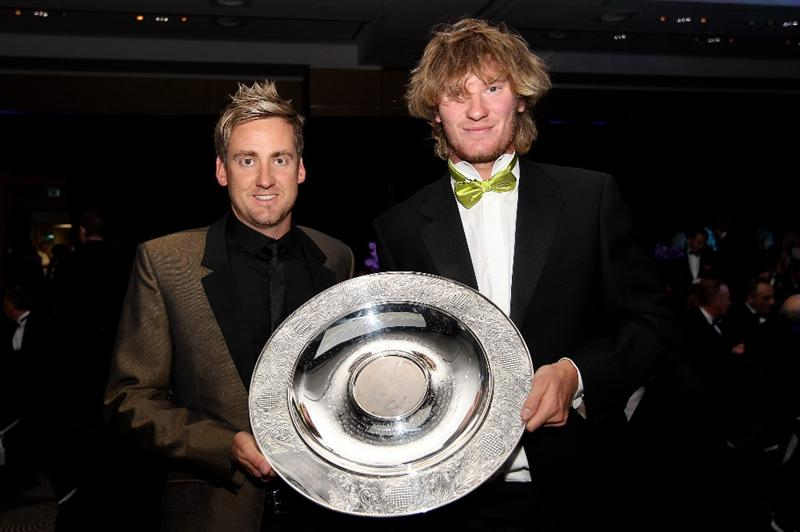 VIRGINIA WATER, ENGLAND - MAY 18:  Ian Poulter of England presents the Rookie of the Year award to Chris Wood (R) of England the 2010 Tour Dinner prior to the BMW PGA Championship on the West Course at Wentworth on May 18, 2010 in Virginia Water, England.  (Photo by Andrew Redington/Getty Images)