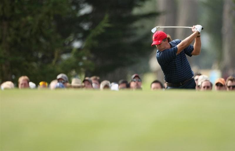SAN FRANCISCO - OCTOBER 09:  Phil Mickelson of the USA Team plays his second shot into the third green during the Day Two Fourball Matches of The Presidents Cup at Harding Park Golf Course on October 9, 2009 in San Francisco, California.  (Photo by Warren Little/Getty Images)