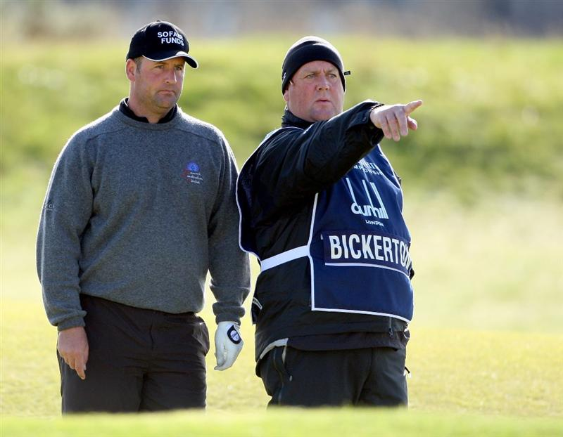 ST. ANDREWS, UNITED KINGDOM - OCTOBER 05: John Bickerton of England with his caddie on the fifth fairway during the final round of The Alfred Dunhill Links Championship at The Old Course on October 5, 2008 in St.Andrews, Scotland.  (Photo by Andrew Redington/Getty Images)