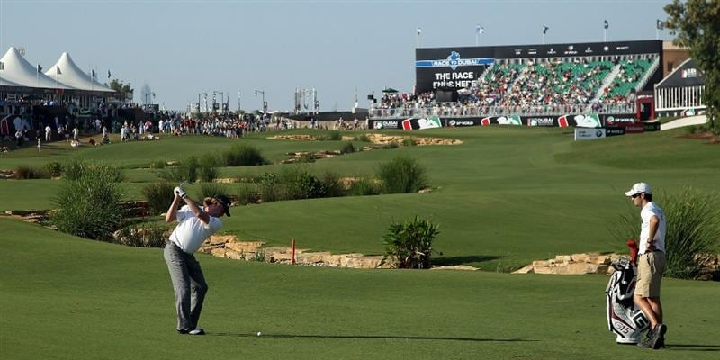 DUBAI, UNITED ARAB EMIRATES - NOVEMBER 26:  Miguel Angel Jimenez of Spain plays his second shot to the par 5, 18th hole during the second round of the Dubai World Championship on the Earth Course at Jumeirah Golf Estates on November 26, 2010 in Dubai, United Arab Emirates.  (Photo by David Cannon/Getty Images)