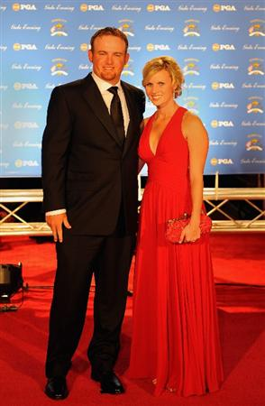 LOUISVILLE, KY - SEPTEMBER 17:  J.B. Holmes of the USA team and wife Sara arrive on the red carpet for the Ryder Cup Gala dinner prior to the start of the 2008 Ryder Cup September 17, 2008 in Louisville, Kentucky.  (Photo by Sam Greenwood/Getty Images)