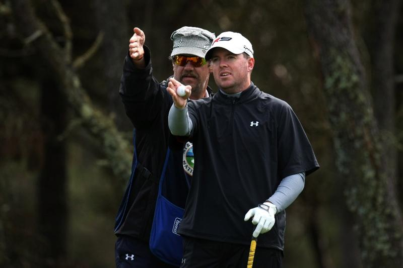 PEBBLE BEACH, CA - FEBRUARY 13: Robert Garrigus and caddy line up his tee shot on the 12th hole at Poppy Hills Golf Course during the second round of the the AT&T Pebble Beach National Pro-Am on February 13, 2009 in Pebble Beach, California. (Photo by Stephen Dunn/Getty Images)