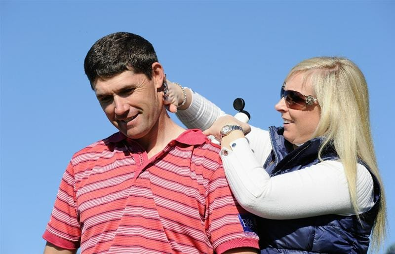 PEBBLE BEACH, CA - FEBRUARY 11:  Caroline Harrington applies suncream to her husband Padraig Harrington of Ireland during the second round of the AT&T Pebble Beach National Pro-Am at the Pebble Beach Golf Links on February 11, 2011  in Pebble Beach, California  (Photo by Stuart Franklin/Getty Images)