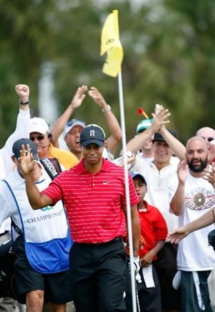 DORAL, FL - MARCH 15:  Tiger Woods reacts after chipping in for birdie on the 6th hole during the final round of the World Golf Championships-CA Championship on March 15, 2009 at the Doral Golf Resort and Spa in Doral, Florida.  (Photo by Jamie Squire/Getty Images)