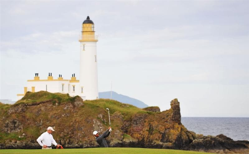 TURNBERRY, SCOTLAND - JULY 14:  Tiger Woods of USA plays a shot in front of the lighthouse during a practice round prior to the 138th Open Championship on July 14, 2009 on the Ailsa Course, Turnberry Golf Club, Turnberry, Scotland.  (Photo by Stuart Franklin/Getty Images)