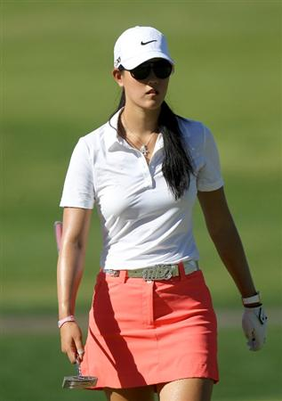 RANCHO MIRAGE, CA - MARCH 31:  Michelle Wie walks on the green on the second hole during the first round of the Kraft Nabisco Championship at Mission Hills Country Club on March 31, 2011 in Rancho Mirage, California.  (Photo by Stephen Dunn/Getty Images)